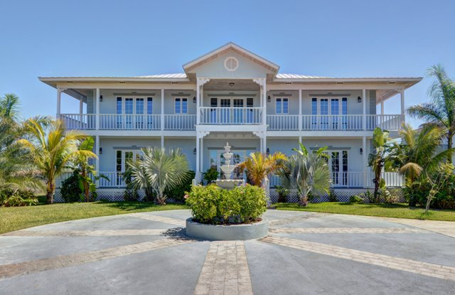 Single Family Home for Sale at Classy Canalfront Caribbean Style Home in Fortune Bay! Fortune Bay, Grand Bahama, Bahamas