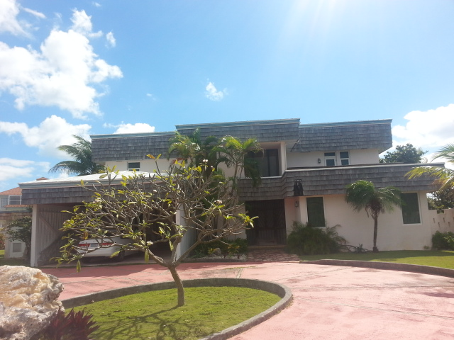 Single Family Home for Sale at Lovely canalfront home with adjoining lot Grand Bahama, Bahamas