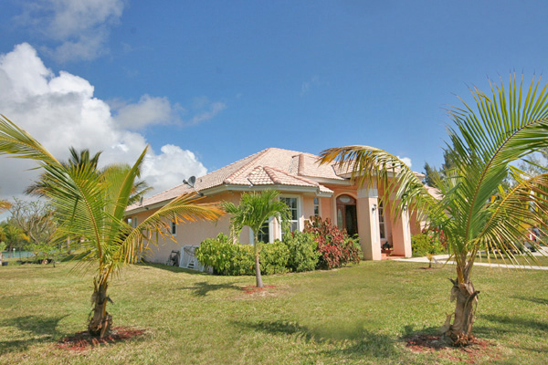 Additional photo for property listing at REDUCED! Island Style CanalFront Home near Beach in Fortune Bay Bahamas