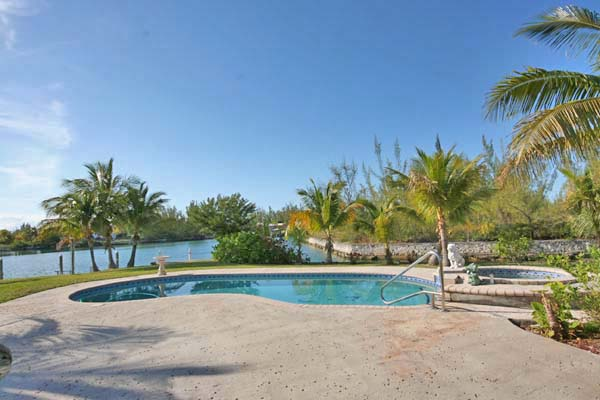 Additional photo for property listing at REDUCED! Island Style CanalFront Home near Beach in Fortune Bay Багамские Острова