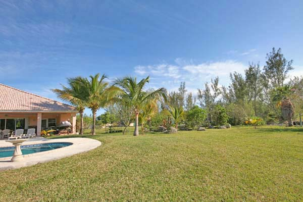 Additional photo for property listing at REDUCED! Island Style CanalFront Home near Beach in Fortune Bay Bahamalar